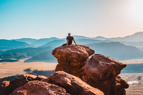 Guy Meditating on Rocks